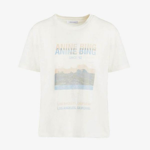 White t-shirt with blurred desert road print and logo