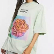 sage green t-shirt with floral graphic print and cycling shorts