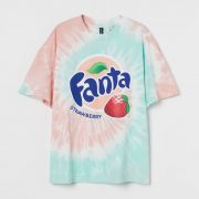 pink and turquoise green tie dye t-shirt with Fanta logo and strawberry logo