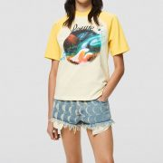yellow and white retro t-shirt with a graphic landscape print by loewe paulas ibiza and raw edge denim shorts