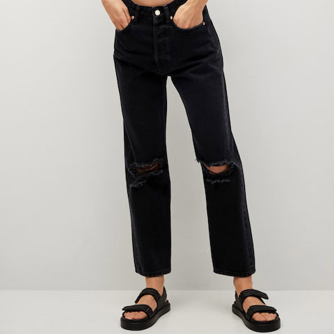 black straight leg jeans and two strap chunky sandals
