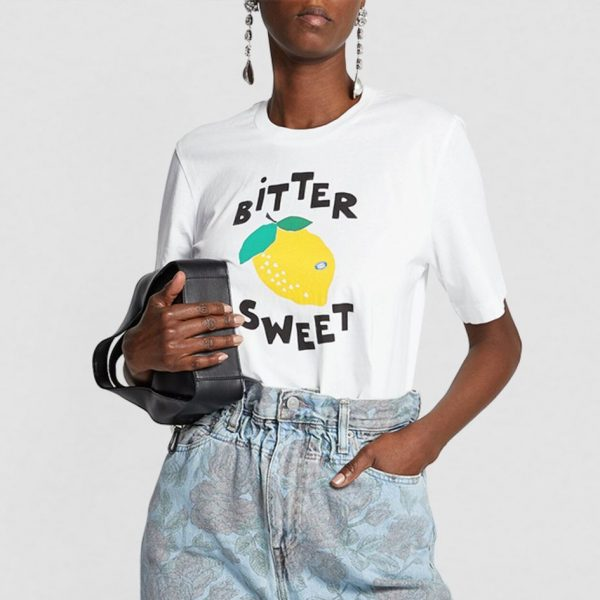 white tshirt with graphic lemon print and bitter sweet writing with a handbag and jeans