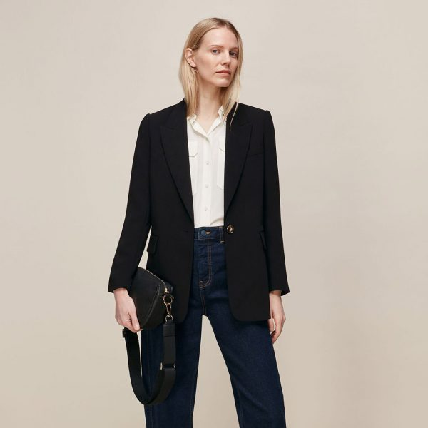 Outfit is a Whistles black boyfriend blazer, jeans and a white shirt