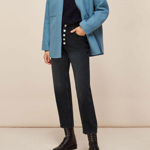 Black straight leg jeans and a denim jacket