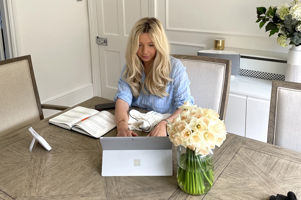 Business woman Olivia of Made of Wright London works at her table