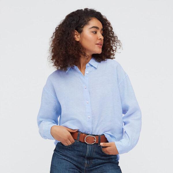 blue linen shirt, denim shorts and tan belt